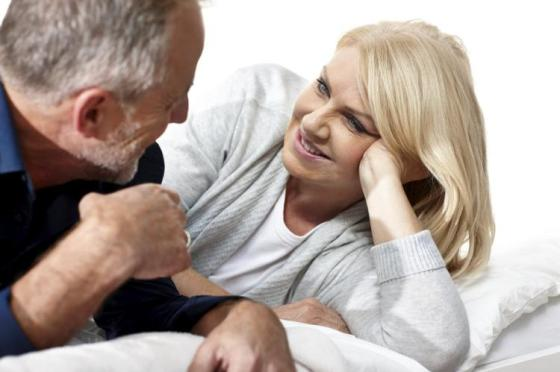 mature-couple-talking-bed